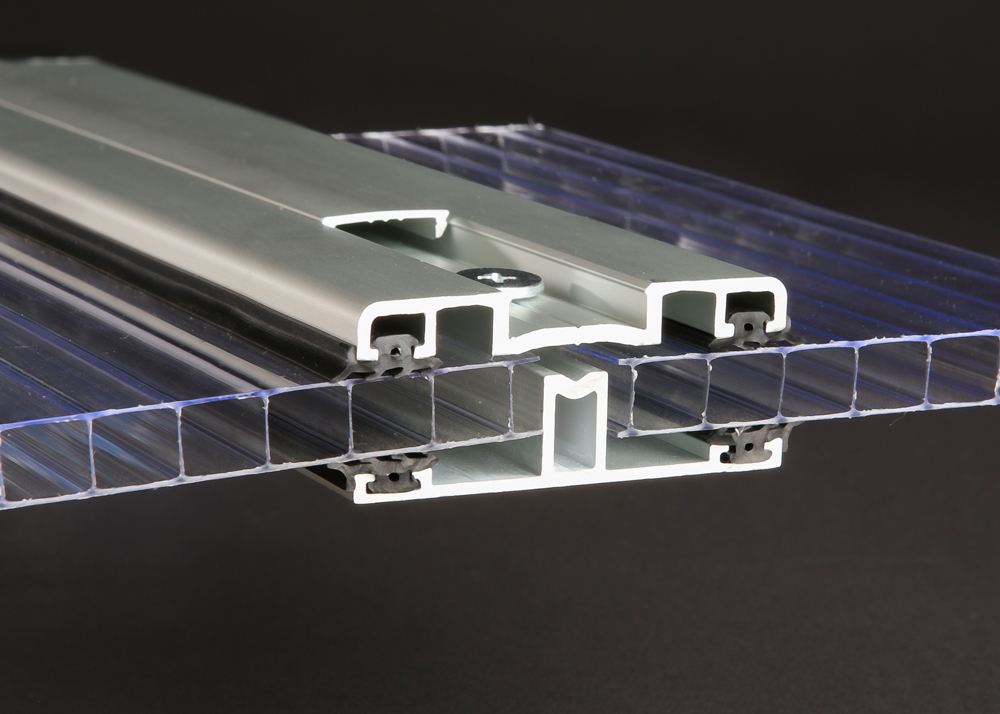 The aluminum Megalock system offers a more effective connection option compared to our Polycarbonate offerings. The Megalock system features a base, cap, and vanity cop cover for a concealed connection. The included gaskets offer a watertight seal. The Megalock system is compatible with sheets up to 16mm and is available in 24' lengths with a clear anodized finished.